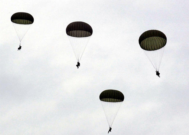 "Members of the Southern Europe Task Force, Vicenza, Italy, train in drop zone ""Juliet"" located 15 miles from Aviano Air Base, Italy. US Army, Air Force, and Italian Army troops jumped from C-130 Hercules aircrafts deployed from the 37th Airlift Squadron, Ramstein Air Base, Germany, as part of a monthly jump training to maintain proficiency. (Duplicate image, see also DF-SD-01-06739 or search 001019-F-3128G-008)"