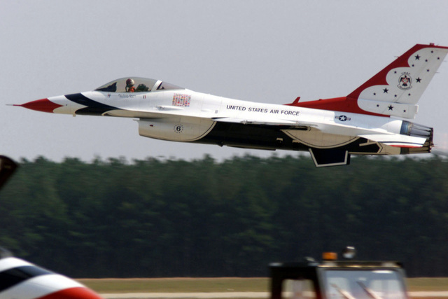 A USAF Thunderbird F-16 Fighting Falcon keeps low to the runway after retracting his landing gear as it increases airspeed after take-off during a show at Shaw Air Force Base, South Carolina