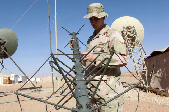 US Air Force AIRMAN First Class Corby Priddy, a Satellite Wide Band Communications Journeyman from the 54th Combat Communications Squadron, Robbins Air Force Base, Georgia, sets up an INMARSAT satellite at Prince Sultan Air Base, Saudi Arabia, during Operation SOUTHERN WATCH. SRA Storm is part of the coalition forces of the 363rd Air Expeditionary Wing, Prince Sultan Air Base, Saudi Arabia, that enforce the no-fly and no-drive zone in Southern Iraq to protect and defend against Iraqi aggression in support of Operation SOUTHERN WATCH