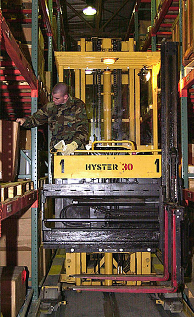 A 31st Supply Squadron member checks warehouse inventory operating a Hyster 30. The members of the 31st SUPS at Aviano Air Base, Italy, are finalists for the 2000 USAFE Daedalian Award. (sub-standard) (Duplicate image, see also DF-SD-01-07006 or search 001024-F-7253S-001)