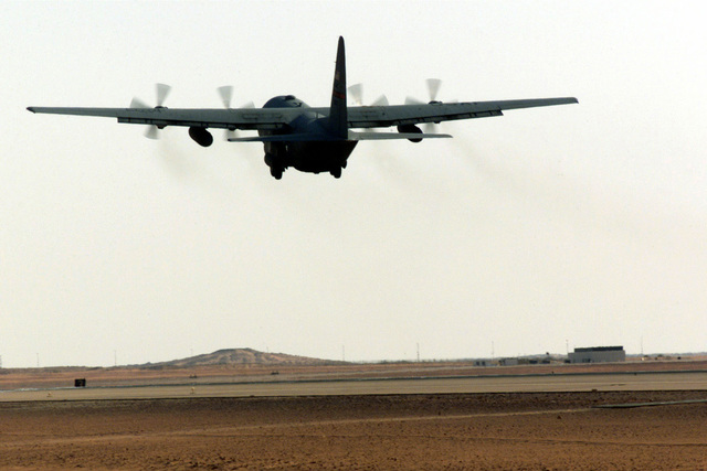 A C-130 Hercules from the 363rd Expeditionary Airborne Squadron (EAS), Prince Sultan Air Base, Saudi Arabia, takes off for its daily mission during Operation SOUTHERN WATCH. The 363rd EAS is part of the coalition forces of the 363rd Air Expeditionary Wing, Prince Sultan Air Base, Saudi Arabia, that enforces the no-fly and no-drive zone in Southern Iraq to protect and defend against Iraqi aggression