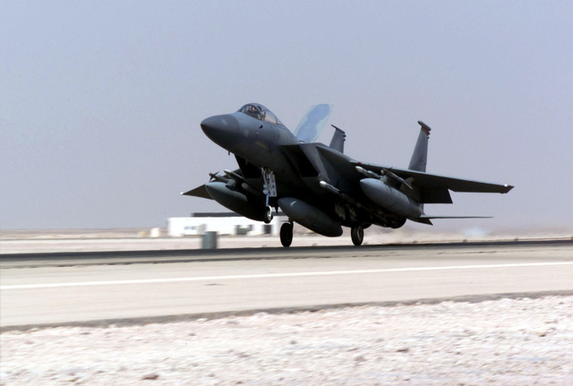 An F-15 Eagle aircraft lands at Prince Sultan Air Base, Saudi Arabia, during Operation SOUTHERN WATCH. The Aircraft is part of the coalition forces of the 363rd Air Expeditionary Wing, Prince Sultan Air Base, Saudi Arabia, that enforces the no-fly and no-drive zone in Southern Iraq to protect and defend against Iraqi aggression