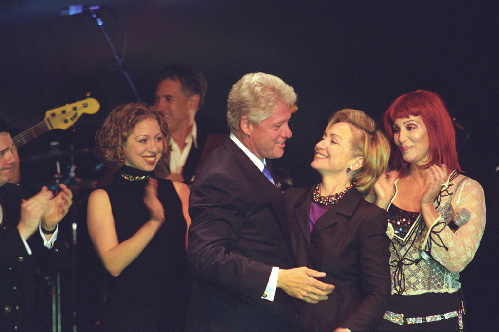 Photograph of President William Jefferson Clinton, First Lady Hillary Rodham Clinton, and Chelsea Clinton on Stage during First Lady Hillary Clinton's Birthday Celebration in New York, New York