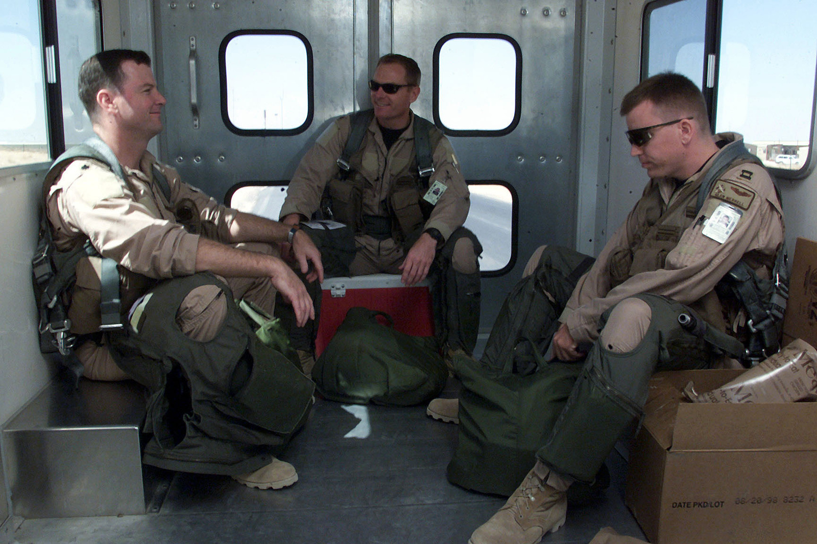 US Air Force F-15 Eagle aircraft pilots from the 122nd Fighter Squadron, Louisiana Air National Guard, sit on a crew bus while being taken out to their aircraft at Prince Sultan Air Base, Saudi Arabia. The pilots are part of the coalition forces of the 363rd Air Expeditionary Wing that enforces the no-fly and no-drive zone in Southern Iraq to protect and defend against Iraqi aggression in support of Operation SOUTHERN WATCH