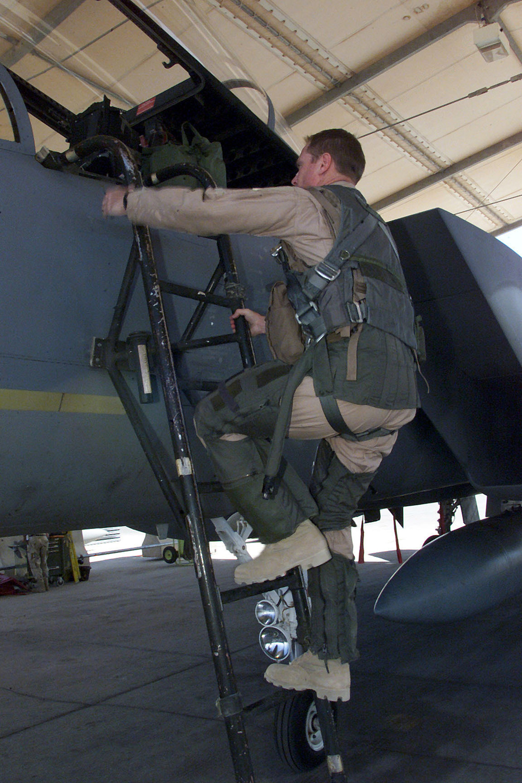 US Air Force Major Floyd Hancock a F-15 Eagle pilot from the 122nd Fighter Squadron, Louisiana Air National Guard, climbs a ladder to get into his aircraft prior to a mission at Prince Sultan Air Base, Saudi Arabia. MAJ Hancock is a part of the coalition forces of the 363rd Air Expeditionary Wing that enforces the no-fly and no-drive zone in Southern Iraq to protect and defend against Iraqi aggression in support of Operation SOUTHERN WATCH