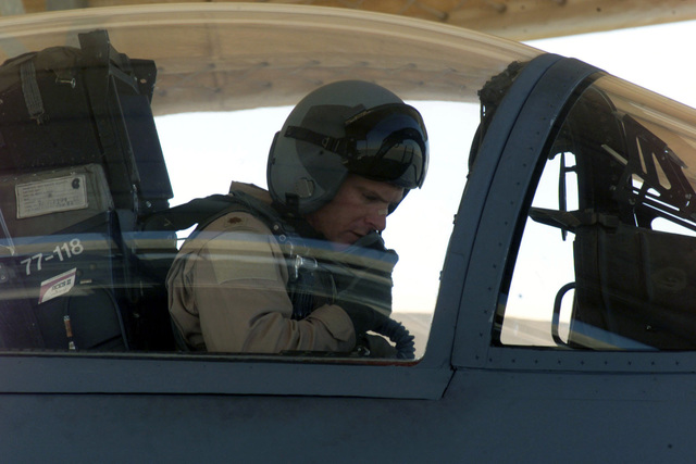 US Air Force Major Floyd Hancock, an F-15 Eagle aircraft pilot from the 122nd Fighter Squadron, Louisiana Air National Guard, performs his preflight check list prior to a mission at Prince Sultan Air Base, Saudi Arabia. MAJ Hancock is a part of the coalition forces of the 363rd Air Expeditionary Wing that enforces the no-fly and no-drive zone in Southern Iraq to protect and defend against Iraqi aggression in support of Operation SOUTHERN WATCH