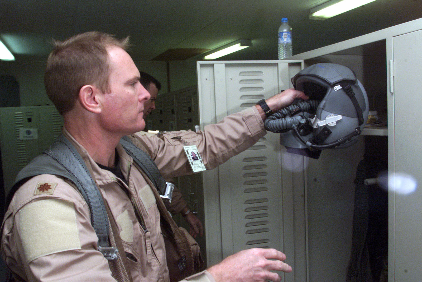 US Air Force Major Floyd Hancock an F-15 Eagle pilot from the 122nd Fighter Squadron, Louisiana Air National Guard, puts on his equipment at life support prior to a mission at Prince Sultan Air Base, Saudi Arabia. MAJ Hancock is a part of the coalition forces of the 363rd Air Expeditionary Wing that enforces the no-fly and no-drive zone in Southern Iraq to protect and defend against Iraqi aggression in support of Operation SOUTHERN WATCH