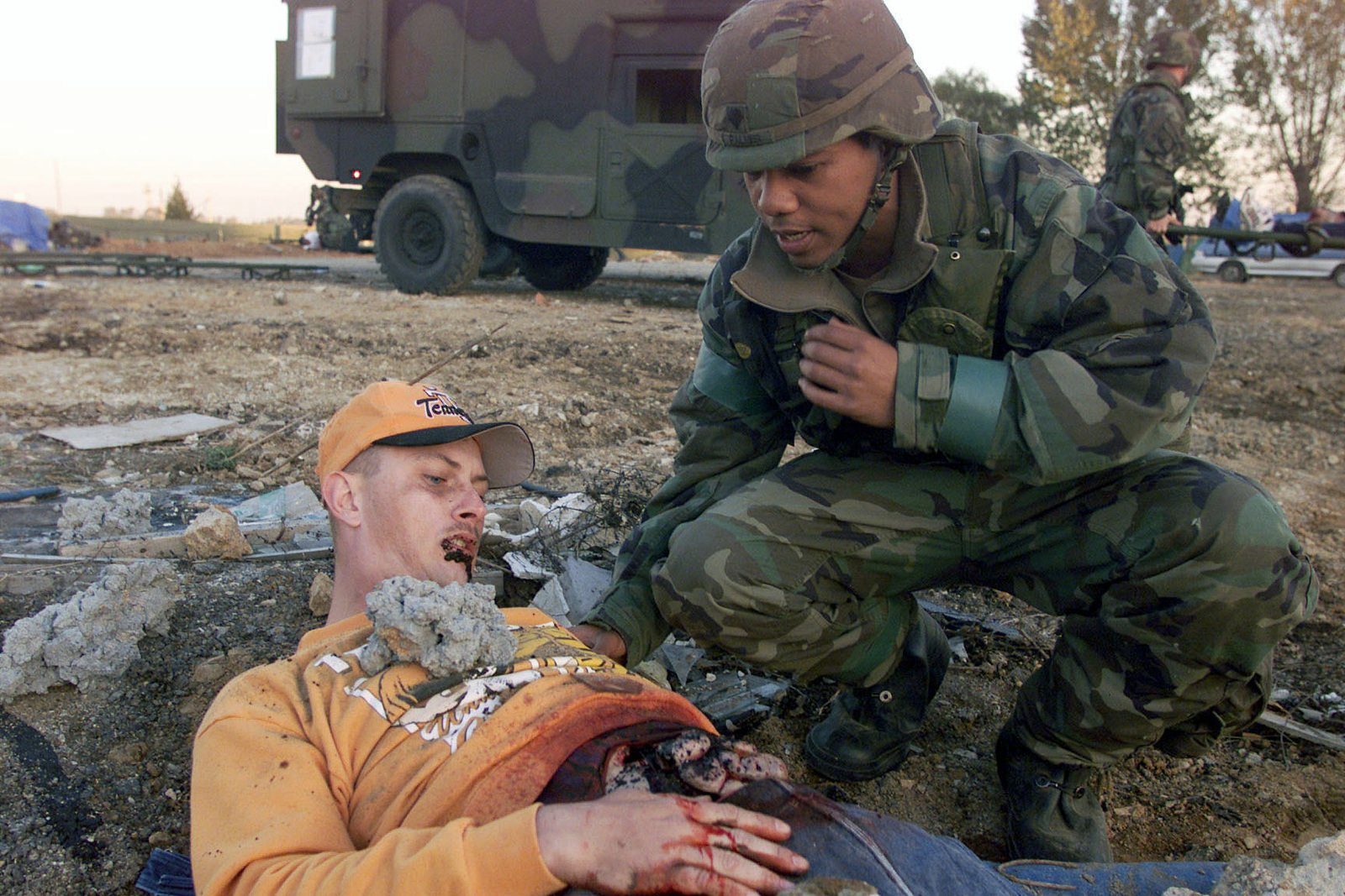A US Army member of the 52nd Medical Evacuation Battallion, Camp Humphries, South Korea, takes part in a medical evacuation exercise during FOAL EAGLE 2000, on October 26th, 2000. FOAL EAGLE is the largest joint and combined field training drill conducted annually in South Korea, running from 25 October to 3 November. About 25,000 U.S. troops will take part in the drill, including active duty, Reserve and National Guard troops from bases in the United States and elsewhere in the Pacific. The exercise demonstrates U.S. and South Korean military cooperation
