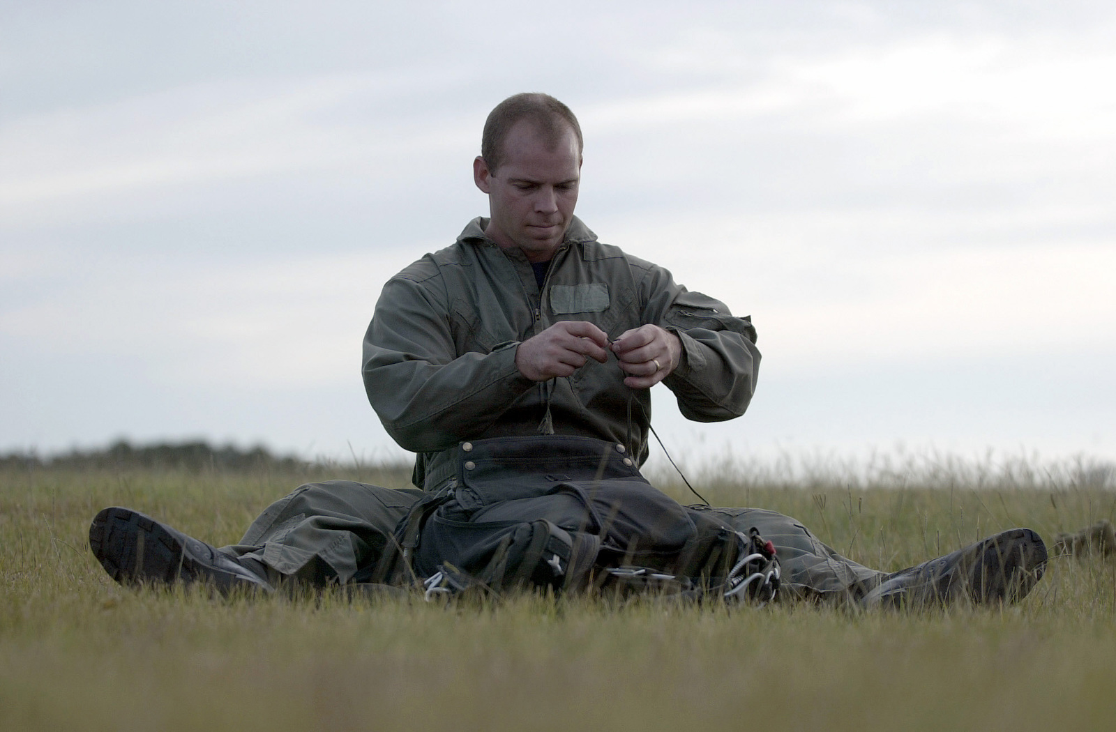 Boatswain's Mate 1ST Class (BM1) Mike Day of SEAL team eight (SEAL8) prepares his parachute for a 10,000 foot jump during JOINT TASK FORCE (JTFEX), UNIFIED SPIRIT 2000