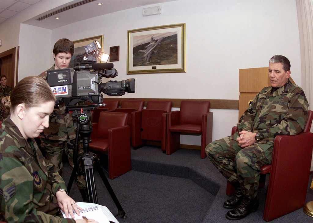 Lieutenant General Paul K. Carlton (Right), Surgeon General of the Air Force, gets interviewed by SRA Heather Columbo (Left), 31st Fighter Wing Public Affairs, Aviano Air Base, Italy. LGEN Carlton toured the 31st Medical Group geographically separated unit (GSU), leased Italian hospital at Sacile, ITA, and engaged 31st MDG leadership on the continuing efforts to optimize primary care