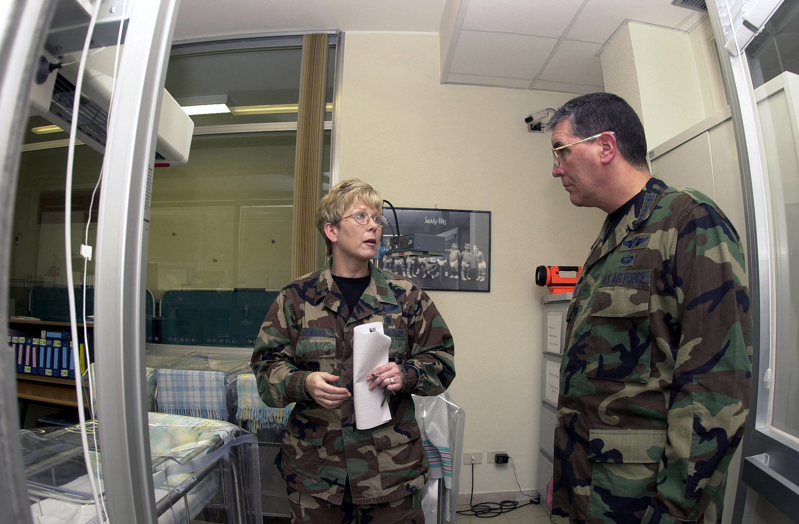 Major Lee Anne Lamer, who heads up the 31st Medical Operations Squadron, for the 31st Medical Group, Aviano Air Base, Italy, shows Lieutenant General Paul K. Carlton, Surgeon General of the Air Force, the post-delivery care room at Sacile Hospital