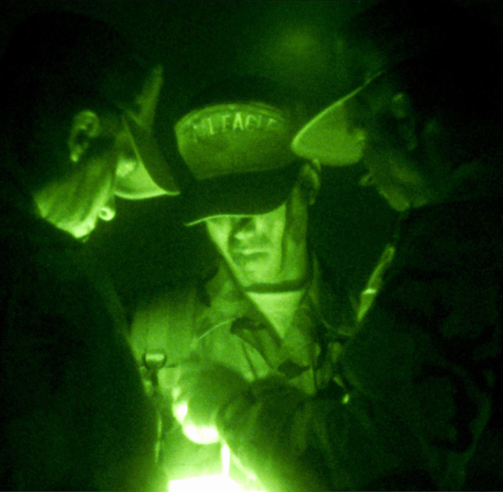 "US Air Force Exercise Evaluation Team (EET) members recheck ""plan of events"" for the evening at Kunsan Air Base, South Korea, during FOAL EAGLE 2000, on October 26th, 2000. FOAL EAGLE is the largest joint and combined field training drill conducted annually in South Korea, running from 25 October to 3 November. About 25,000 U.S. troops will take part in the drill, including active duty, Reserve and National Guard troops from bases in the United States and elsewhere in the Pacific. The exercise demonstrates U.S. and South Korean military cooperation"
