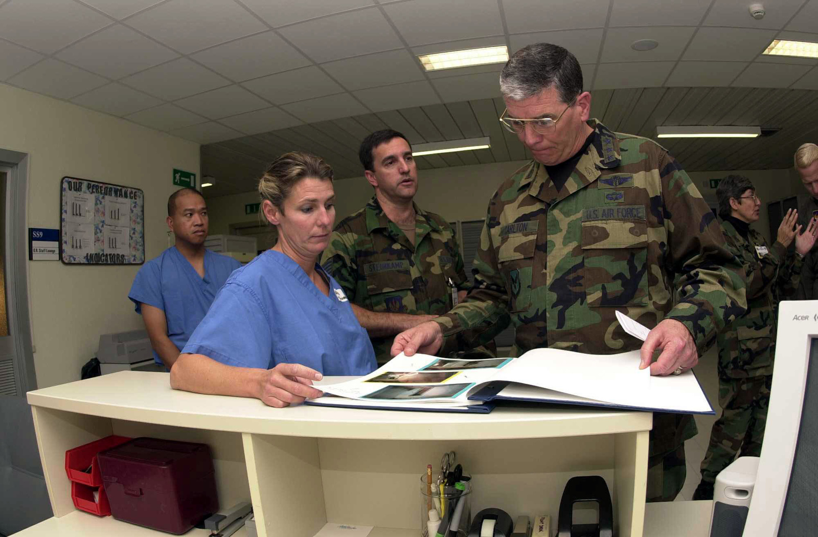 US Air Force Major Kimberly A. Thomas (Left foreground), a Surgical Services Provider for the 31st Medical Group, Aviano AIr Base, Italy, briefs USAF Lieutenant General Paul K. Carlton, Surgeon General of the Air Force, on the 31st Medical Group's rennovation efforts at Sacile Hospital