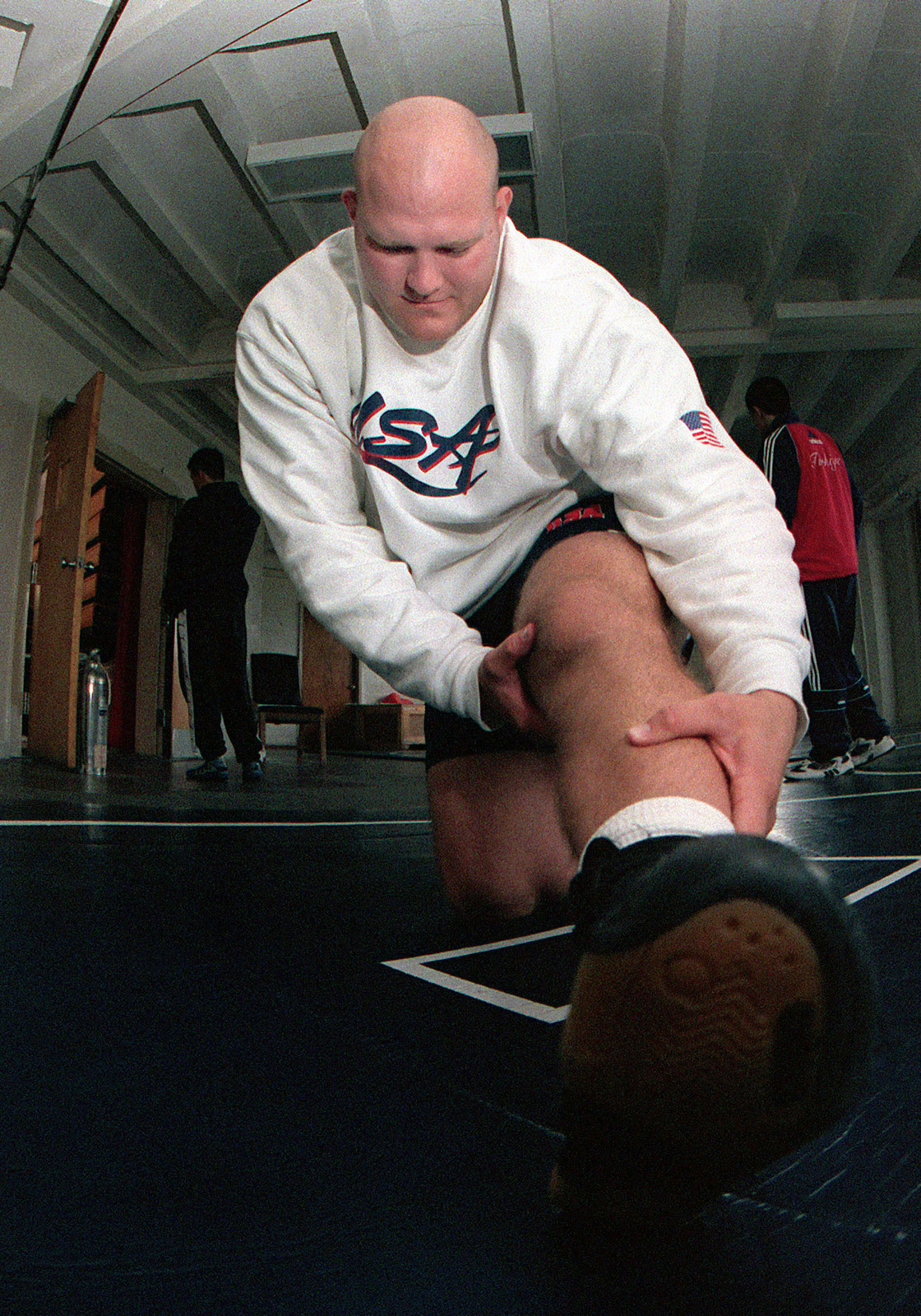 US Air Force SENIOR AIRMAN Corey Farkas, 10th Civil Engineering Squadron, Peterson Air Force Base, Colorado, stretches before his match at the 19th World Military Wrestling Championships held at Camp Lejeune Marine Corps Base, North Carolina, on October 26th, 2000. The Conseil International du Sport Militaire 19th World Military Wrestling Championship (CISM) is a multi-national wrestling tournament hosted by Lejeune, from Oct. 25-29. Competing nations include: Brazil, China, Estonia, Finland, Germany, Greece, Slovakia, Turkey, the United States and Vietnam. Wrestlers will be competing in two different competitions, Free-Style and Greco-Roman