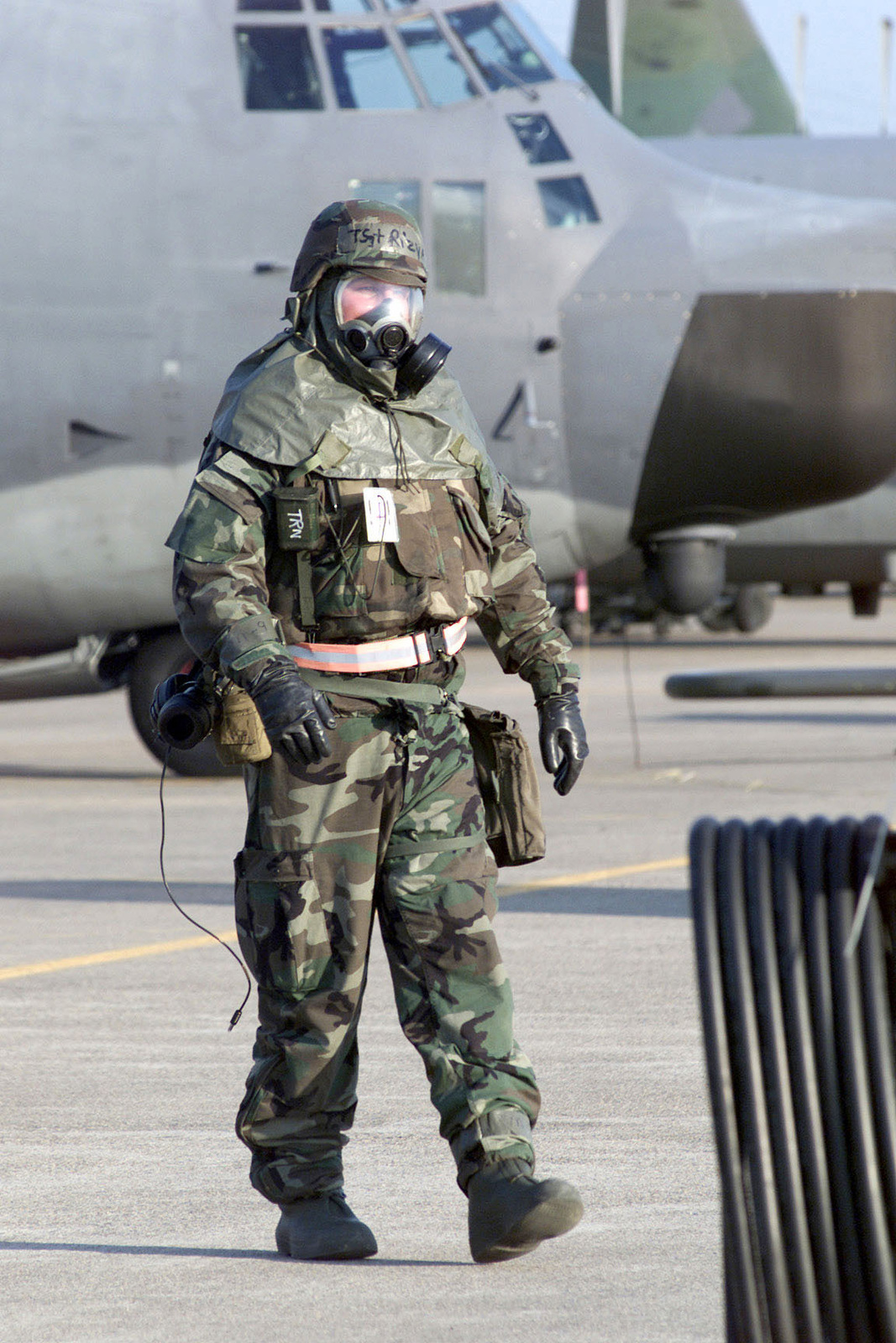 US Air Force Technical Sergeant Rob Rizya works on the Taegu Air Base, Korea, flightline while wearing Mission-Oriented Protective Posture response level 4 (MOPP-4) gear, following a simulated chemical attack during exercise FOAL EAGLE 2000. TSGT Rizya is assigned to the 353rd Special Operations Group and is deployed to Taegu from Kadena Air Base, Okinawa. FOAL EAGLE is held annually in South Korea to demonstrate U.S. and South Korean military cooperation and is the U.S. Militarys largest Joint-Service, Multi-National field training drill. This year's drill involves about 25,000 active duty, Reserve, and National Guard troops from the United States and bases throughout the Pacific Command...