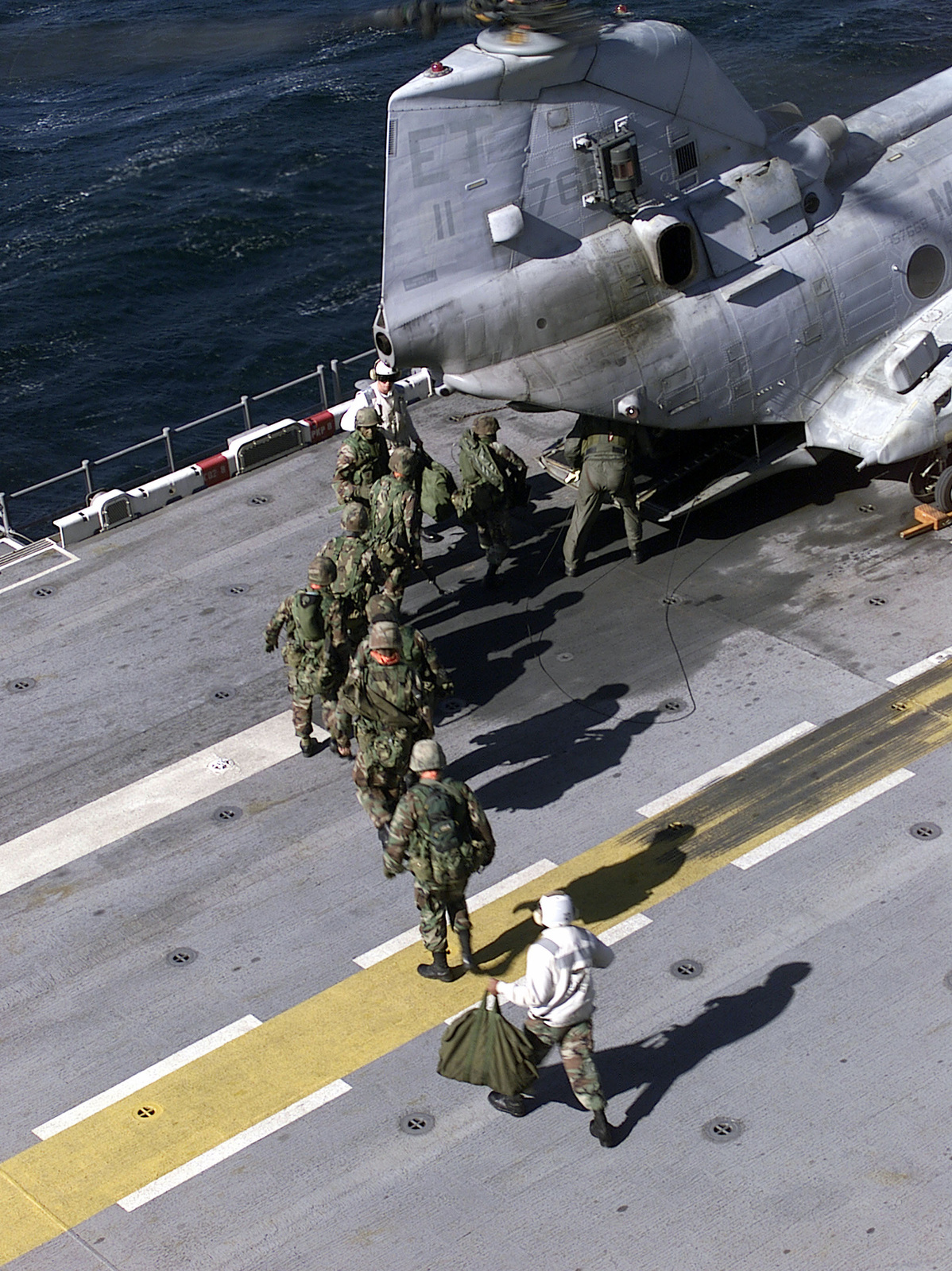 US Marines from Battalion Landing Team (BLT) load into the rear of a US Marine CH-46 (Sea Knight) helicopter to be flown ashore for their mission in the FOAL EAGLE 2000 exercise in Pohang, Korea. US Marines from the 31st Marine Expeditionary Unit spent two months participating in various training operations on and off the coast of Okinawa, Japan, Sasebo, Japan, Pohang, Korea, and Hong Kong, China