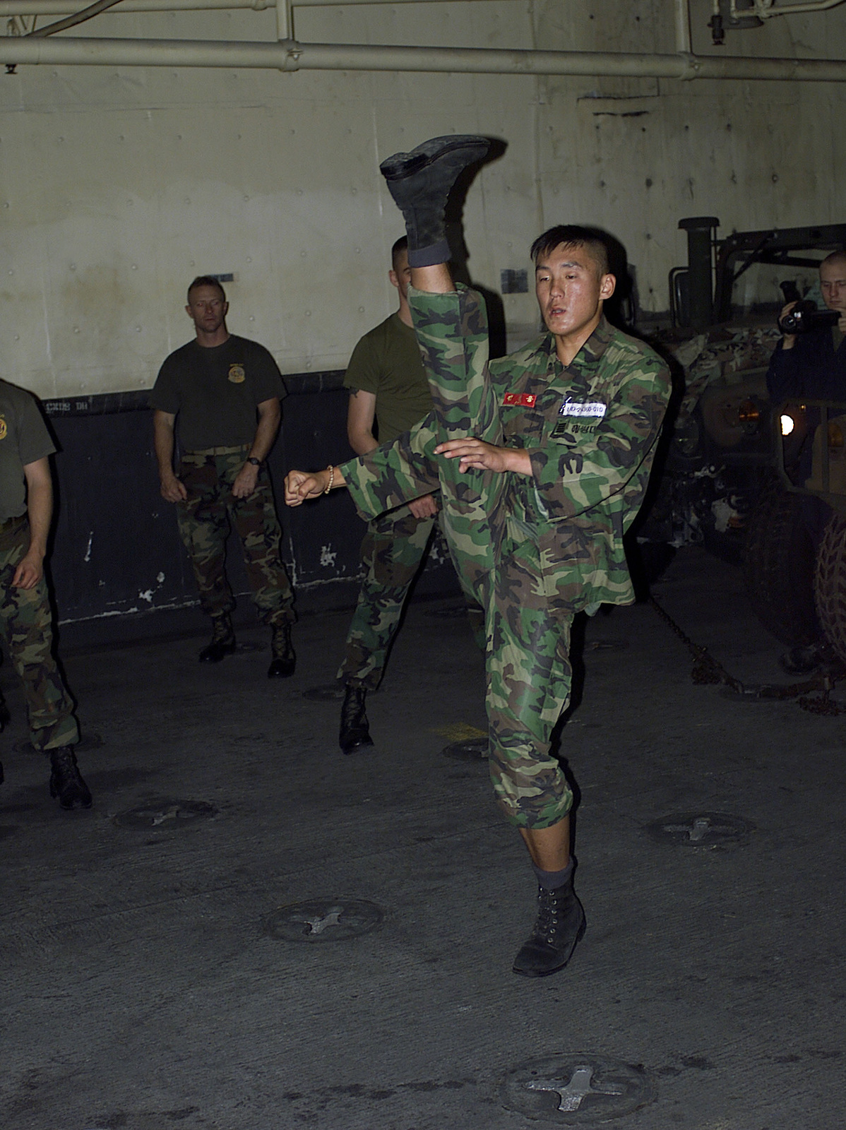 A Republic of Korea (ROK) Marine shows the US Marines how they battle during close combat, aboard the USS Essex (LHD 2) during the FOAL EAGLE 2000 exercise, while off the coast of Pohang, Korea. US Marines from the 31st Marine Expeditionary Unit (MEU), spent two months participating in various training operations on and off the coast of Okinawa, Japan, Sasebo, Japan, Pohang, Korea, and Hong Kong, China