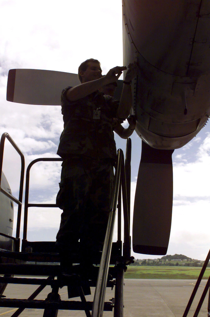 A US Air Force engine mechanic with the 193rd Special Operations Wing, Pennsylvania Air National Guard, during post flight inspection of an EC130E Hercules aircraft. The 193rd Special Operations Wing is deployed to Kadena Air Base in support of Operation FOAL EAGLE 2000