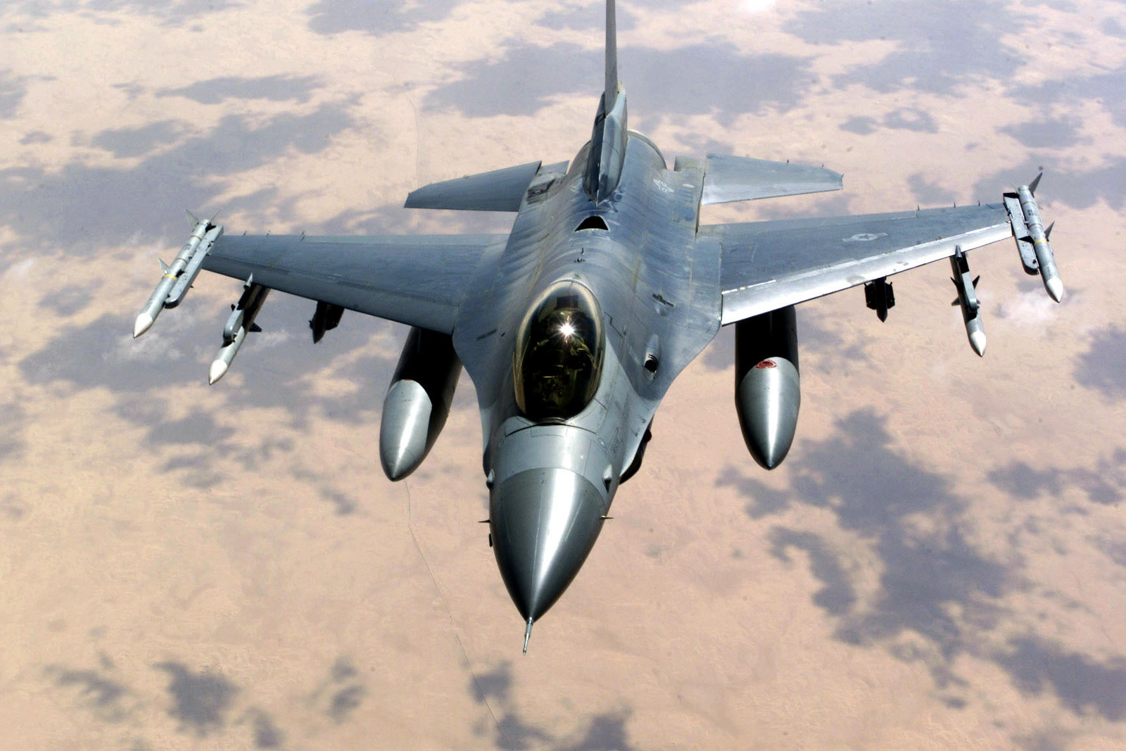 An F-15 Eagle aircraft over Saudi Arabia in support of Operation SOUTHERN WATCH. The F-15 is armed with AIM 7 Sparrow missiles and AIM 120 advanced medium-range air-to-air missiles (AMRAAM) and is part of the coalition forces of the 363rd Air Expeditionary Wing who enforce the no-fly and no-drive zone in Southern Iraq to protect and defend against Iraqi aggression