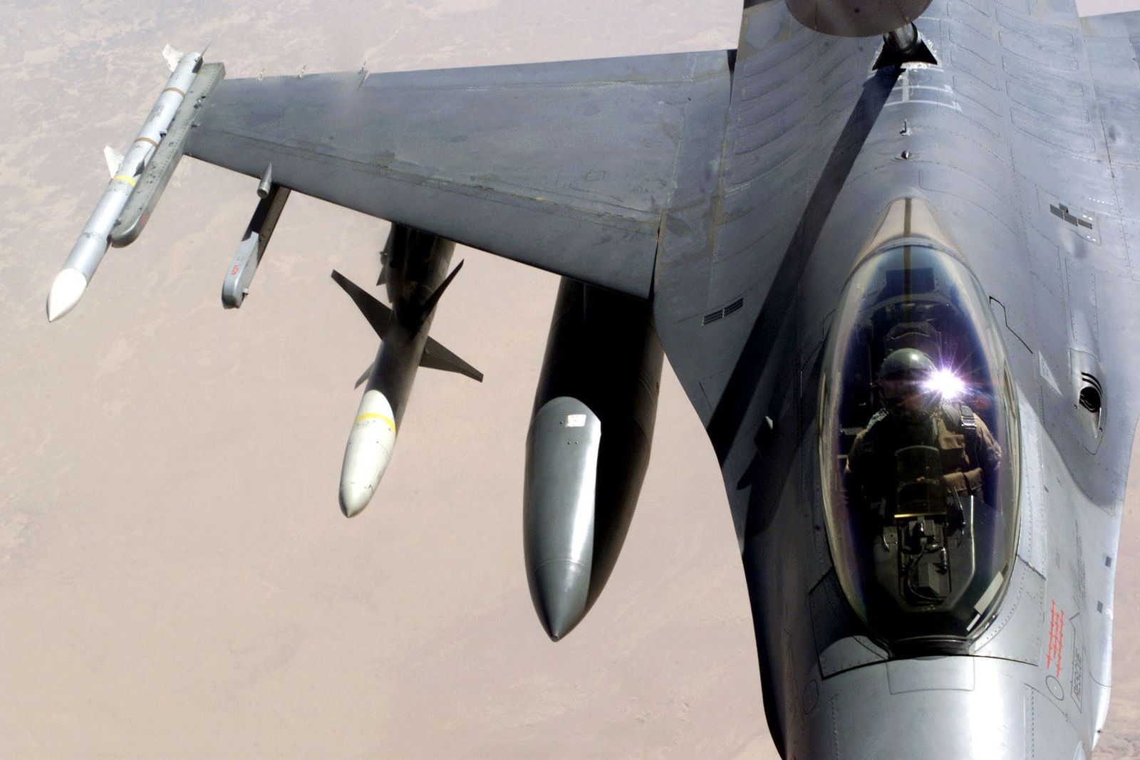 An F-15 Eagle aircraft refuels from a K-135 Stratotanker aircraft (not shown) over Saudi Arabia in support of Operation SOUTHERN WATCH. The F-15 is equipped with AIM 7 Sparrow missiles and AIM 120 advanced medium-range air-to-air missiles (AMRAAM) and is part of the coalition forces of the 363rd Air Expeditionary Wing who enforce the no-fly and no-drive zone in Southern Iraq to protect and defend against Iraqi aggression