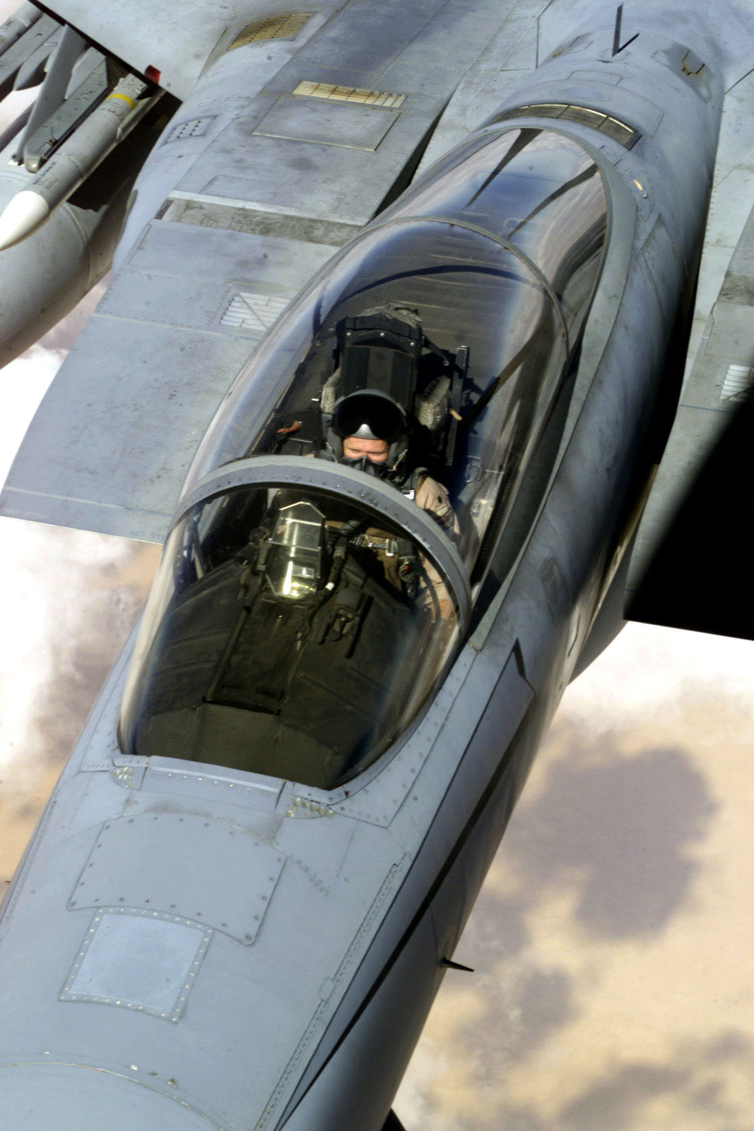 An F-15 Eagle aircraft refuels from a KC-135 Stratotanker (not shown) over Saudi Arabia in support of Operation SOUTHERN WATCH. The F-15 is part of the coalition forces of the 363rd Air Expeditionary Wing who enforce the no-fly and no-drive zone in Southern Iraq to protect and defend against Iraqi aggression