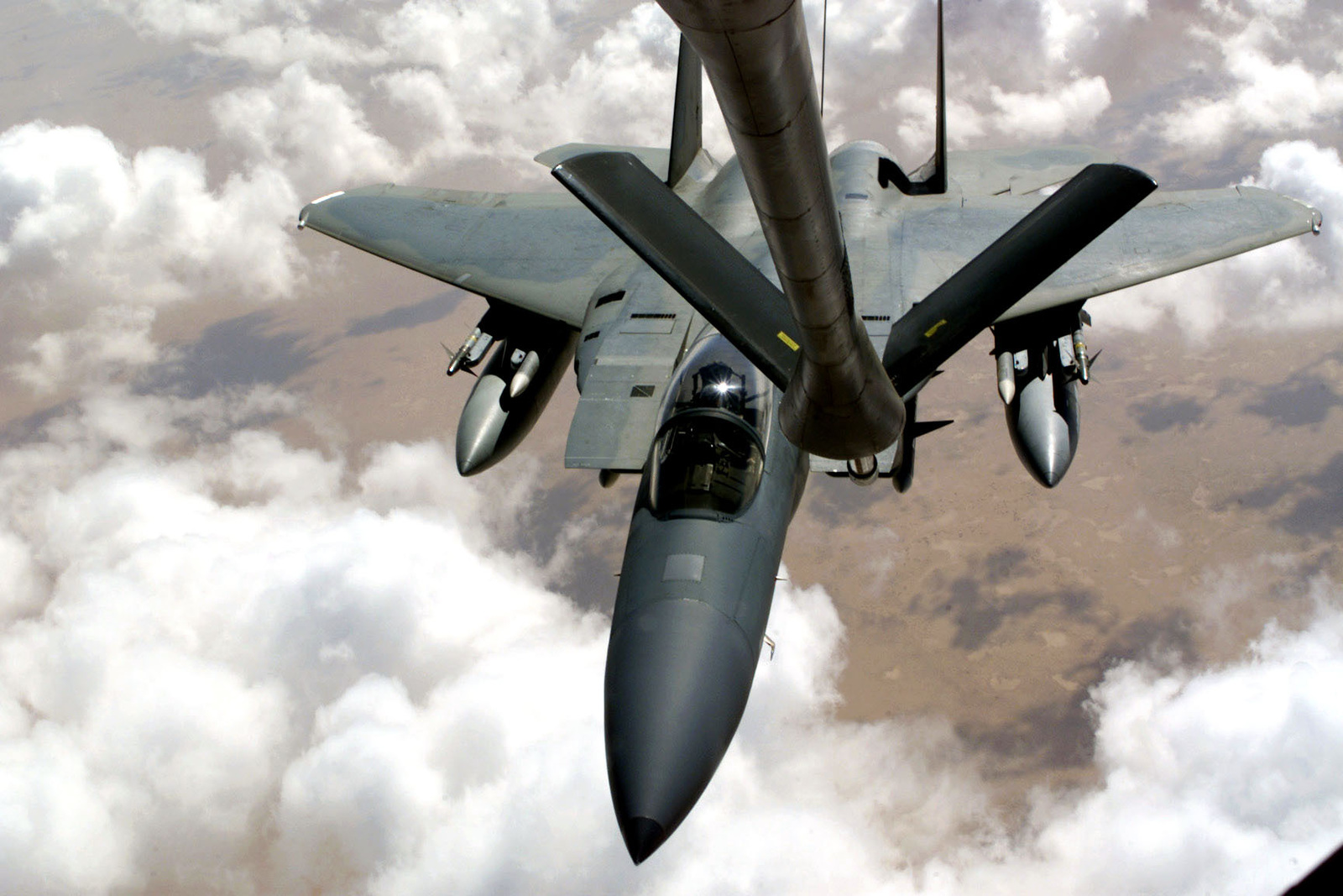 An F-15 Eagle aircraft refuels from a KC-135 Stratotanker (not shown) over Saudi Arabia in support of Operation SOUTHERN WATCH. The F-15 is equipped with AIM 7 Sparrow missiles and AIM 120 advanced medium-range air-to-air missiles (AMRAAM) and is part of the coalition forces of the 363rd Air Expeditionary Wing who enforce the no-fly and no-drive zone in Southern Iraq to protect and defend against Iraqi aggression