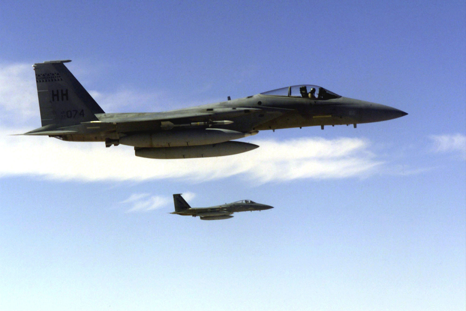 Two F-15 Eagle aircrafts over Saudi Arabia in support of Operation SOUTHERN WATCH. The F-15s are a part of the coalition forces of the 363rd Air Expeditionary Wing who enforce the no-fly and no-drive zone in Southern Iraq to protect and defend against Iraqi aggression
