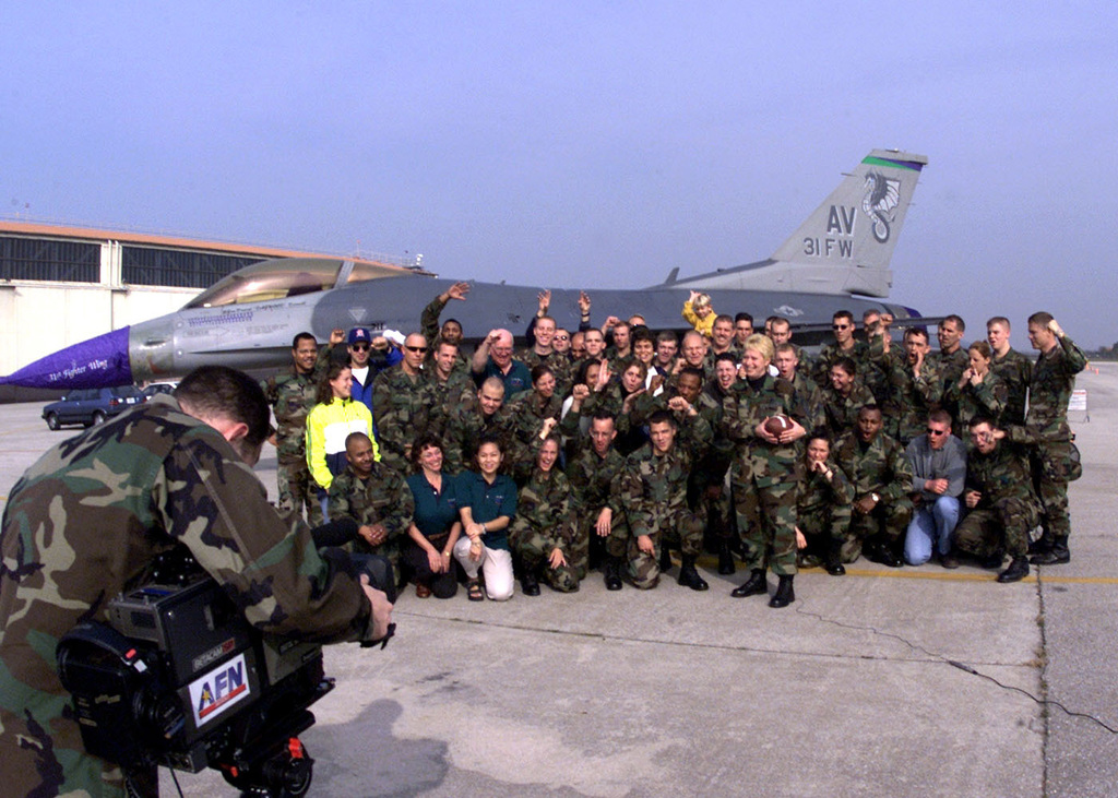 United States Air Force in Europe Command CHIEF MASTER Sergeant Vickie C. Mauldin shoots a Super Bowl commercial for Armed Forces Network at Aviano Air Base, Italy. CMSGT Mauldin is surrounded by football crazed troops attending Aviano's Safety Day Block Party