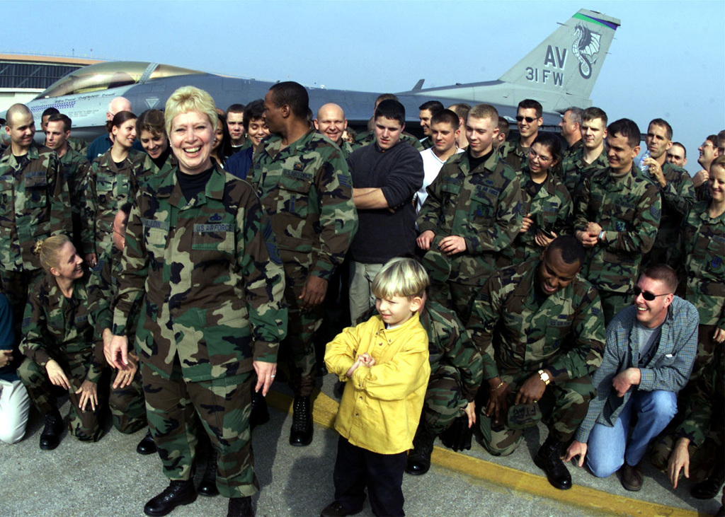United States Air Force in Europe Command CHIEF MASTER Sergeant Vickie C. Mauldin during taping for a Super Bowl commercial for Armed Forces Network at Aviano Air Base, Italy. CMSGT Mauldin is surrounded by football crazed troops attending Aviano's Safety Day Block Party