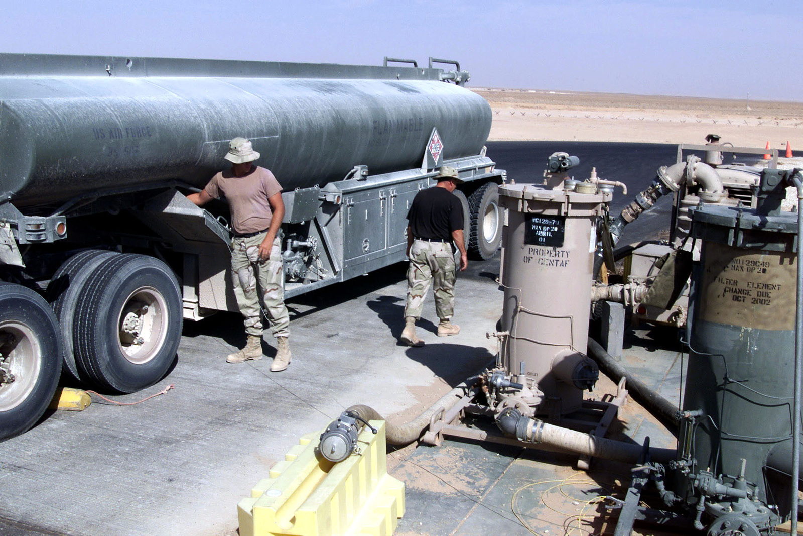 US Air Force AIRMAN First Class Billy Christy, 363rd Expeditionary Supply Squadron, Fuels Flight, Prince Sultan Air Base, Saudi Arabia, attaches a hose to his truck to pump fuel to a bladder. A1C Christy is part of the coalition force here to support Operation SOUTHERN WATCH, a military effort to enforce the no-fly and no-drive zone in Southern Iraq