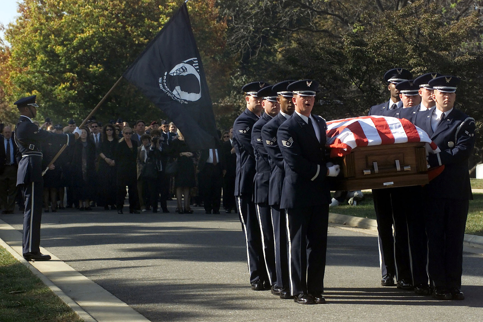 US Air Force members hold a flag draped coffin during a full honor funeral for US Air Force Second Lieutenant Richard Vandegeer at Arlington National Cemetery on October 27, 2000