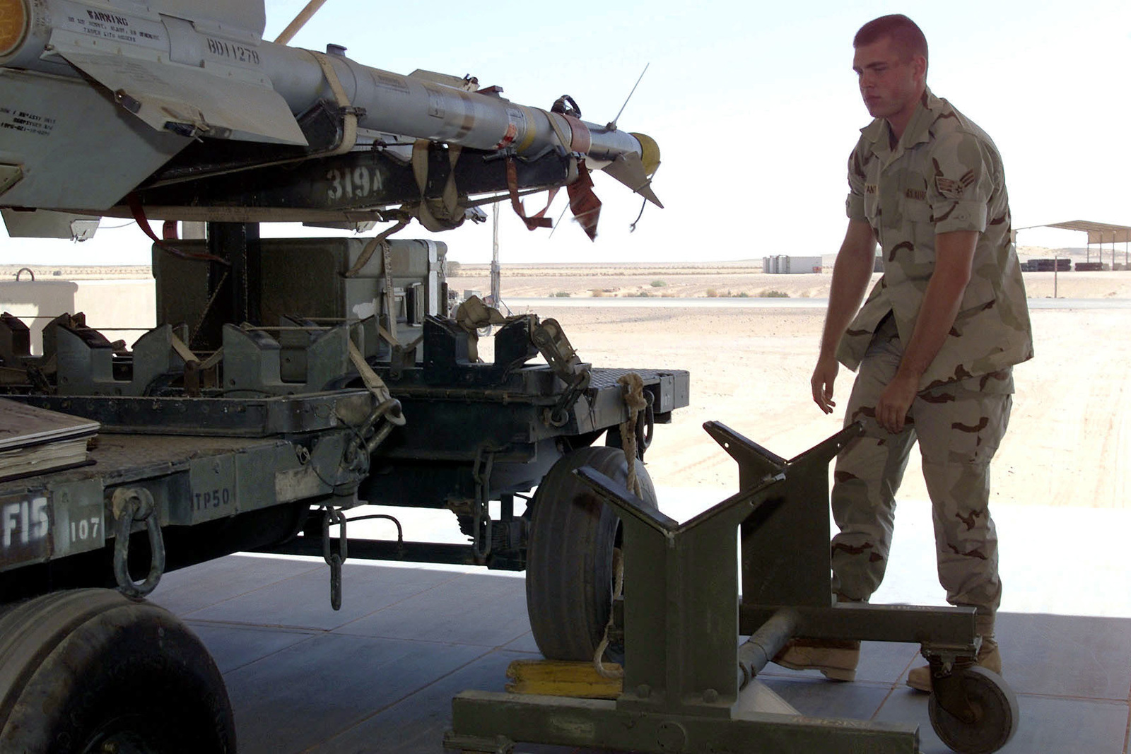 US Air Force SENIOR AIRMAN Daniel J. Bryant, 363rd Expeditionary Maintenance Squadron, Prince Sultan Air Base, Saudi Arabia, prepares to off-load munitons. SRA Bryant is part of the coalition force here to support Operation SOUTHERN WATCH, a military effort to enforce the no-fly and no-drive zone in Southern Iraq