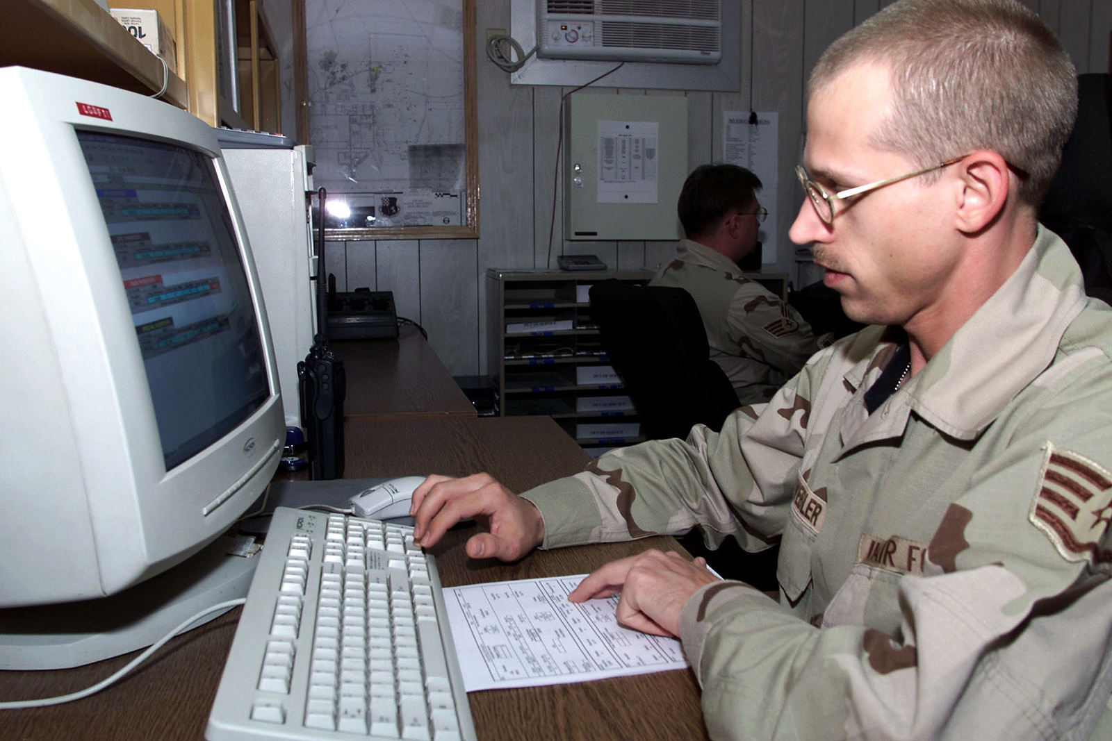 US Air Force STAFF Sergeant Keith A. Schwebler, 363rd Expeditionary Supply Squadron, Prince Sultan Air Base, Saudi Arabia, updates reports in the squadrons control center. SSGT Schwebler is part of the coalition force here to support Operation SOUTHERN WATCH, a military effort to enforce the no-fly and no-drive zone in Southern Iraq