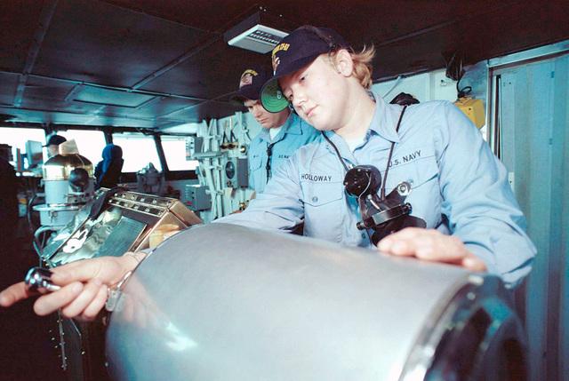 As a Helmsmen on board the USS KITTY HAWK (CV 63), Seamen Jennifer Holloway and Seamen Jessie Jones guide her in the Sea of Japan