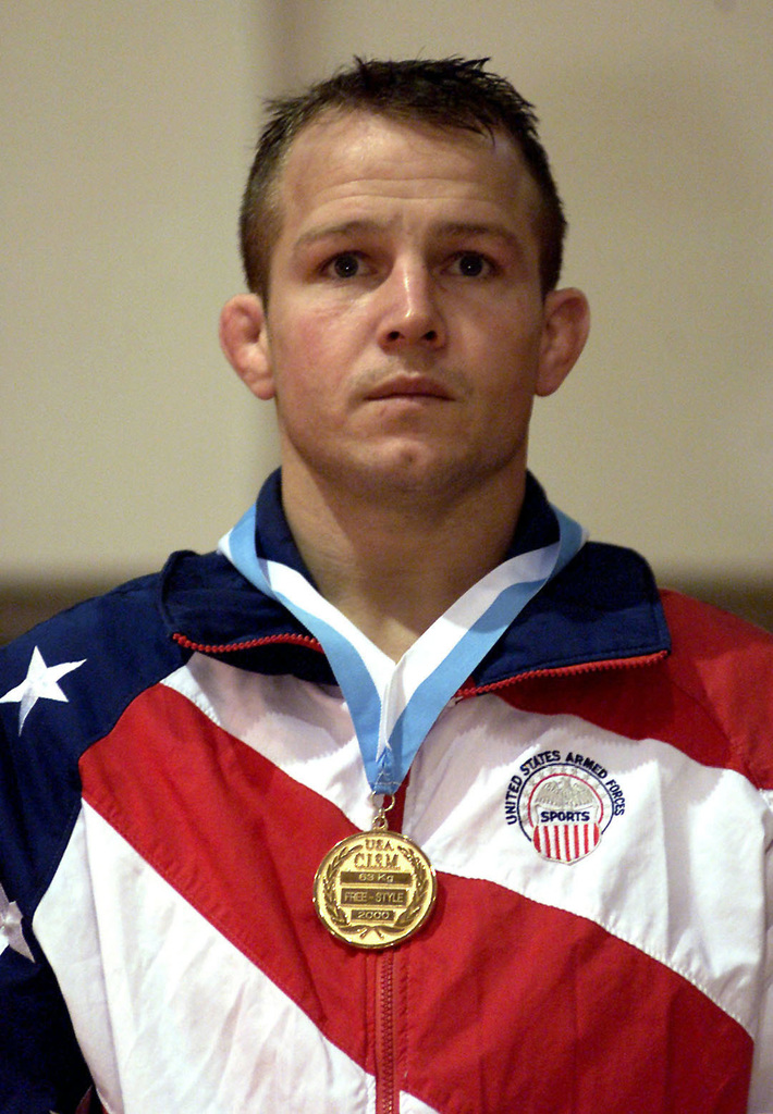 US Army SPECIALIST Jeff Beddard, Fort Carson, Colorado, wears the Gold Medal after beating Surigalatu (Not shown), from China, during the finals of the 63Kg Free-Style, 19th World Military Wrestling Championship, on October 29th, 2000. SPC Beddard won the match 9-1 taking home the Gold. Surigalatu took Silver. The Conseil International du Sport Militaire 19th World Military Wrestling Championship (CISM) is a multi-national wrestling tournament hosted by Marine Corps base Camp Lejeune, N.C., 25-29 Oct. 00. Competing nations include: Brazil, China, Estonia, Finland, Germany, Greece, Slovakia, Turkey, United States and Vietnam. The wrestlers will be competing in two different competitions, ...