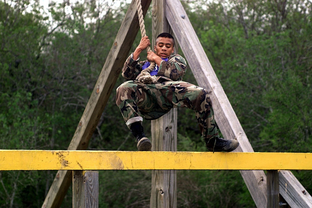 Air Combat Commands SENIOR AIRMAN Martinez Dzajic displays superb athletic skill as he completes the Swing, Stop, and Jump Obstacle during the Fitness Challenge Event of DEFENDER CHALLENGE 2000, a competition at Lackland Air Force Base, Texas, on October 30th, 2000. DEFENDER CHALLENGE is the annual Air Force wide competition sponsored by Air Force Security Forces. This competition showcases the talents and capabilities of 13 international Security Forces teams in seven physical fitness, base defense and policing skills over six days