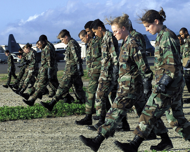 US Air Force Security Alert Response Team (SART) members walk the search line looking for remains at the exercise crash site, during the MAJOR ACCIDENT RESPONSE EXERCISE (MARE) at Hickam Air Force Base, Hawaii, on October 30th, 2000