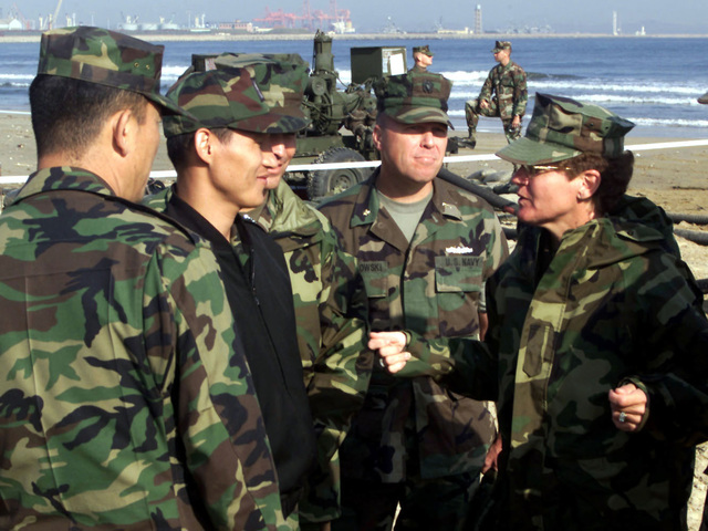 US Marine Corps Brigadier General Frances Wilson (Right), Commander, 3rd Force Service Support Group, Okinawa, Japan, talks with Republic of Korea (ROK) Lieutenant Commander Dong Jae Lee (In black jacket), Combined Forces Command (CFC), C-4, while observing the D-Day Mobile Fuel Distribution System (DMFDS) concept demonstration at Gogu Beach, South Korea, in support of FOAL EAGLE 2000 on October 30, 2000. The DMFDS is a Force Warfighting Lab (FWL) sponsored and Office of Naval Research (ONR) funded project which demonstrates new techniques in the first ever transfer of fuel from the sea to land. FOAL EAGLE 2000 is the largest Joint and Combined field training drill conducted annually in ...