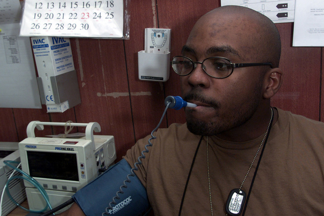 US Air Force STAFF Sergeant Derrolda Burley, a pharmacy technician from the 89th Medical Group, Andrews Air Force Base, Maryland, gets his temperature taken at Prince Sultan Air Base, Saudi Arabia. SSGT Burley is a part of the 363rd Air Expeditionary Wing that enforces the no-fly and no-drive zone in Southern Iraq to protect and defend against Iraqi aggression in support of Operation SOUTHERN WATCH