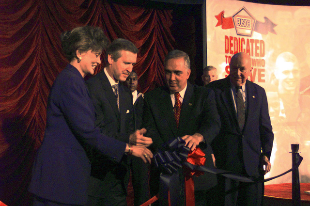 US Secretary of Defense William S. Cohen and US Army General John H. Tilelli, Jr. (retired), President and CEO of the USO Worldwide Operations join ribbons for the dedication of the new USO passageway located at the Pentagon, Corridor 10. Also shown are Mrs. Janet Langart Cohen and David O.Cook, Pentagon Director of Administration and Management