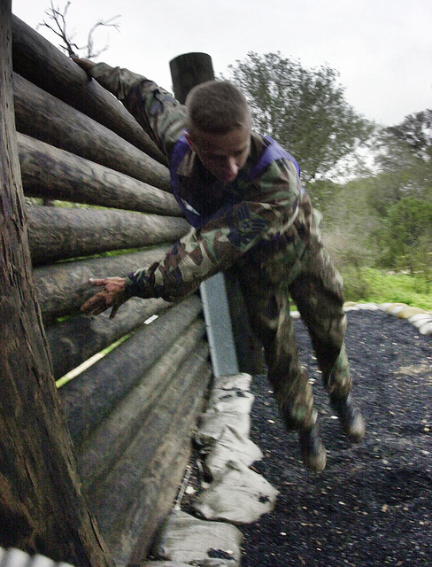 An 11th Wing, Bolling Air Force Base, Washington DC, team member negotiates one of the many obstacles during the CHIEF's Challenge portion of DEFENDER CHALLENGE 2000. This event pits individuals against the obstacle course at Lackland Air Force Base, Texas. The Defender Challenge competition showcases the talents and capabilities of 13 international Security Forces teams in seven physical fitness, base defense, and policing skills over six days