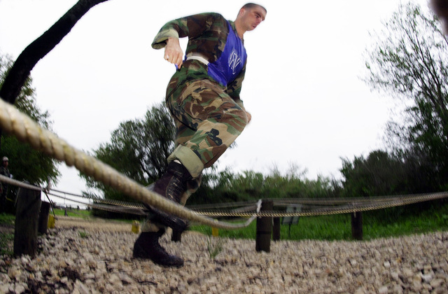 An Air Force Material Command team member takes careful steps during the CHIEF's Challenge portion of DEFENDER CHALLENGE 2000. This event pits individuals against the obstacle course at Lackland Air Force Base, Texas. The Defender Challenge competition showcases the talents and capabilities of 13 international Security Forces teams in seven physical fitness, base defense, and policing skills over six days
