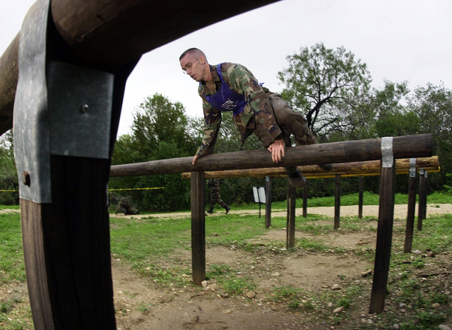 An Air Force Security Police Center team member negotiates one of the many obstacles during the CHIEF's Challenge portion of DEFENDER CHALLENGE 2000. This event pits individuals against the obstacle course at Lackland Air Force Base, Texas. The Defender Challenge competition showcases the talents and capabilities of 13 international Security Forces teams in seven physical fitness, base defense, and policing skills over six days