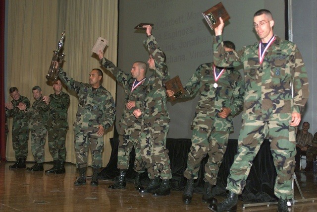 Team members from Air Force Space Command show off their trophies for coming in second in the Fitness Challenge competition during the awards ceremony for DEFENDER CHALLENGE 2000 at Lackland Air Force Base, Texas. Defender Challenge is the annual Air Force wide competition sponsored by Air Force Security Forces. This competition showcases the talents and capabilities of 13 international Security Forces teams in seven physical fitness, base defense and policing skills over six days