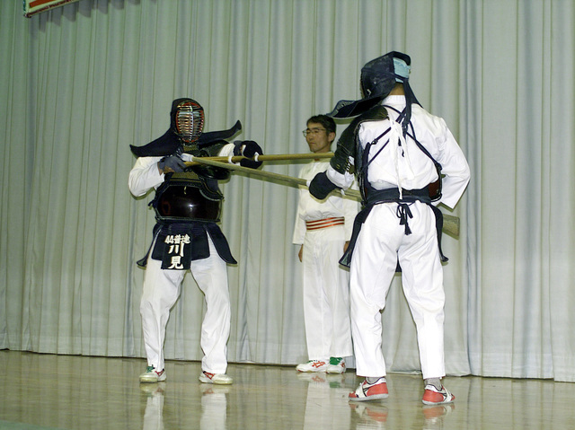 Japanese soldiers demonstrate techniques of their native close combat skills at the Opening Ceremony Celebration during Forest Light 2000. Forest Light is a cultural enhancing, combined arms exercise in which Marines from 1ST Battalion, 6th Marine Regiment train with soldiers from the 44th Infantry Regiment, Japanese Ground Self Defense Force (JGSDF). The units train side by side teaching each other various weapons systems, different tactical offenses and defenses, as well as close combat skills