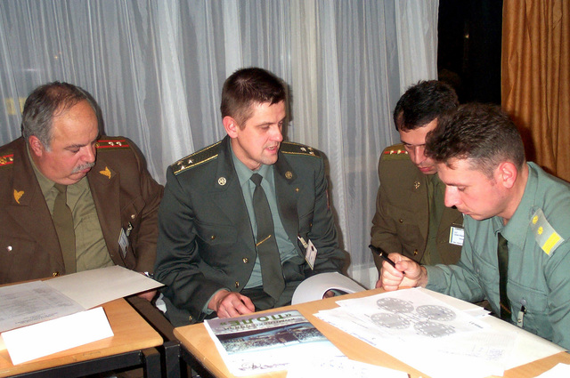 Team member from Georgia, Ukraine and Moldova plan the testing phase during the initial planning conference held in the Ukrain for Exercise COMBINED ENDEAVOR on Nov. 6, 2000. COMBINED ENDEAVOR will take place at Lager Aulenbach Germany from 10-24 May, 2001. COMBINED ENDEAVOR is a Partnership for Peace (PfP) exercise focused on multinational communications and information-systems interoperability. (Duplicate image, see also DFSD0107943 or search 001107F6369T005)