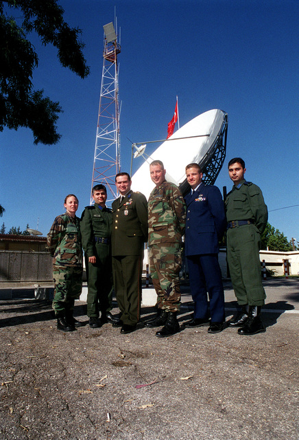 (left to right) US Air Force Captain Andrea Gormel, 39th Wing CHIEF of Military Justice, First Lieutenant Kader Sumer, Turkish Air Force Communications Squadron Commander, Captain Oktay Seyifoglu, Turkish General STAFF CHIEF Communication Electronics Information Representative, USAF Lieutenant Colonel John Nolan, 39th Communications Squadron Commander, USAF CAPT Don Carter, Communications officer and interpreter with the Office of Defense Cooperation in Ankara, and 1LT Birol Guvenc, Turkish Air Force Communications Squadron Division Commander, pose for a group photo during the Defense and Economic Cooperation Agreement inspection at Incirlik Air Base, Turkey, November 7th, 2000