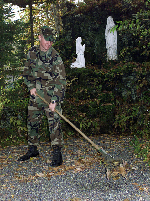 US Navy Lieutenant (LT), Steven B. Zurek, assigned to 3rd Battalion, 12th Marine Regiment, 3D Marine Division, rakes leaves, as part of a community relations effort at an orphanage near, East Camp Fuji, Japan. This training area is part of the units nine firing day relocation shoot, designed to enhance military occupational specialty proficiency within the artillery field