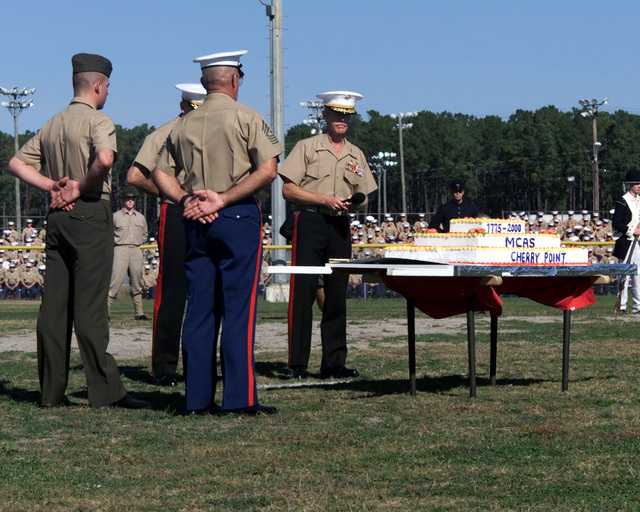 US Marine Corps Major General (MGEN), Thomas A. Braaten and Major General (MGEN), Dennis T. Krupp, recognize Sergeant Major (SGM) Peter Gante and Private First Class (PFC), Mitcheal Hall Jr., as the oldest and youngest Marines. Part of the Marine Corps 225th Birthday celebration held at Marine Corps Air Station (MCAS), Cherry Point, NC