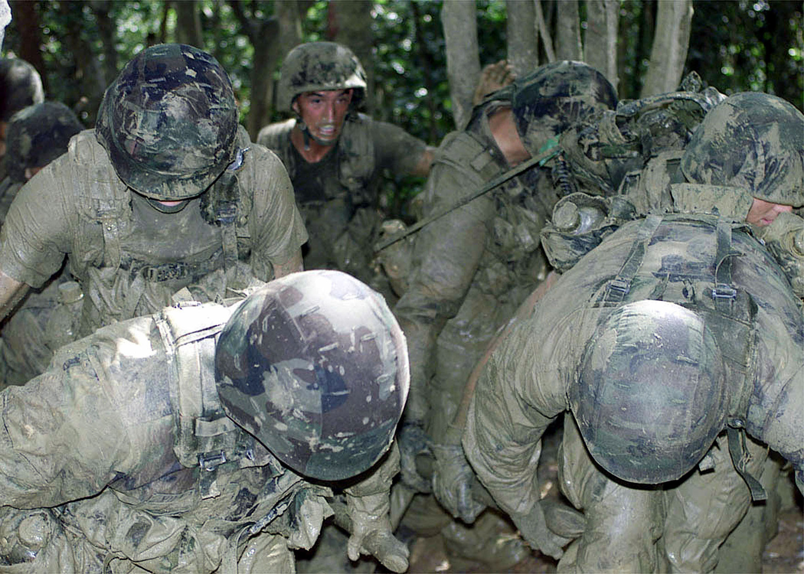 Covered with mud, US Marines from 3D Marine Division Communication